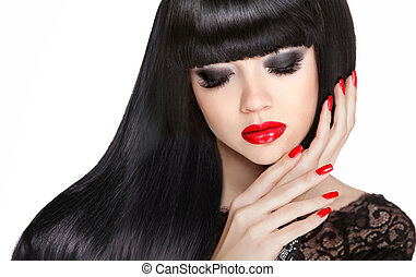 Red lips and manicured nails Brunette girl model with long...
