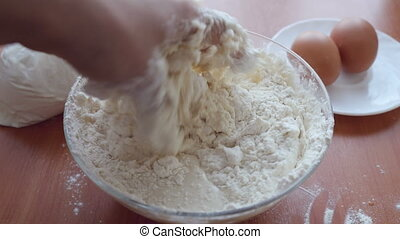 Preparing Dough, hands mixing ingredients. - Preparing...