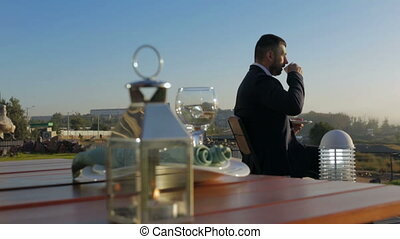 young businessman drinking morning coffee