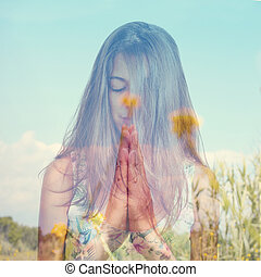 double exposure of a young woman meditating and a peaceful...