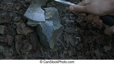Sharpening axe on stone