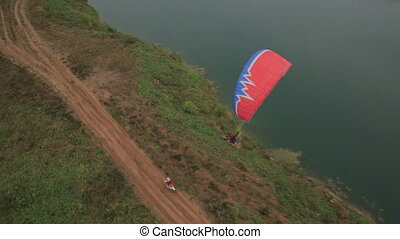 the bike competes with the glider, aerial shot