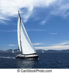 Yacht sails with beautiful cloudles - Sailing. Yacht sails...