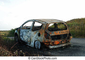 Car Crime - A car which has been abandoned and burned out.