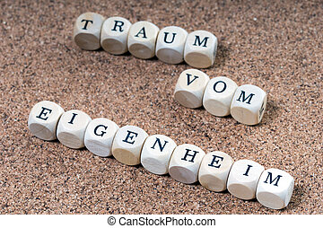 dream of home ownership - Wooden cubes and the words dream...