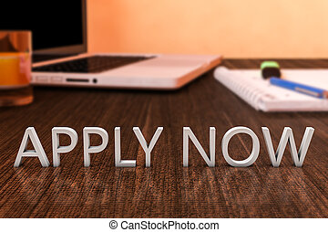 Apply now - letters on wooden desk with laptop computer and...