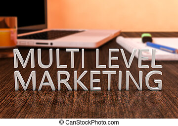 Multi Level Marketing - letters on wooden desk with laptop...