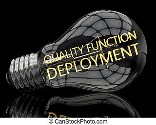 Quality Function Deployment - lightbulb on black background...