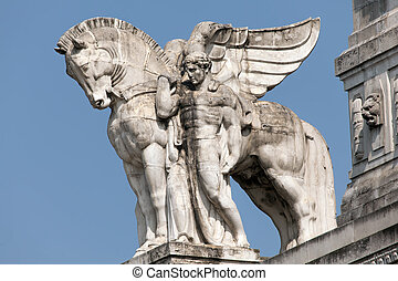 Statue of a man holding a winged horse on the Milans main...