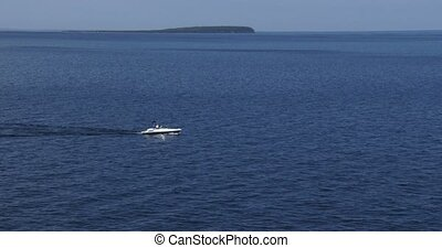 Boat navigating on calm lake - Boat navigating on the calm...