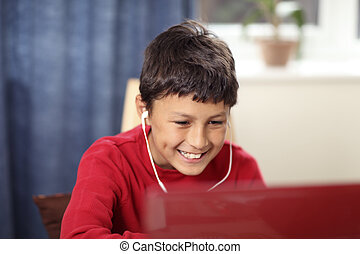 Young boy doing homework on computer - Young boy doing his...
