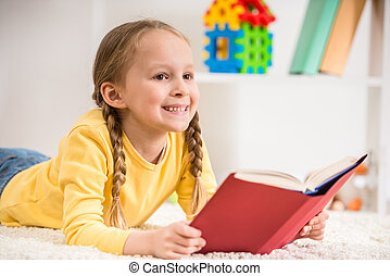 Girl reading book - Little pretty girl in yellow pullover...