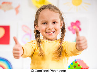 Little girl making thumbs up - Little pretty smiling girl in...