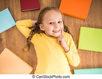 Girl with books - Little pretty smiling girl in yellow...