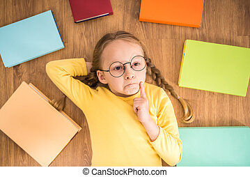 Girl with books - Little pretty girl in yellow pullover and...