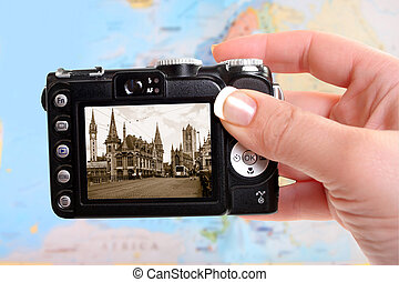Ghent Belgium - Woman's tourist hand holds camera taking a...