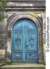 ancient blue gate to a tomb