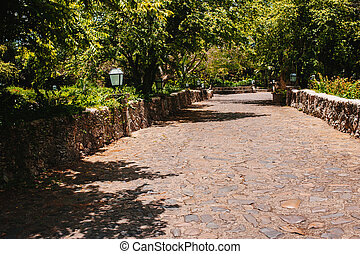 Road in tropical park Ancient village Altos de Chavon -...