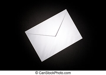 closed envelope with white spot light on black background