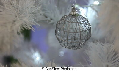 ball on a white Christmas tree