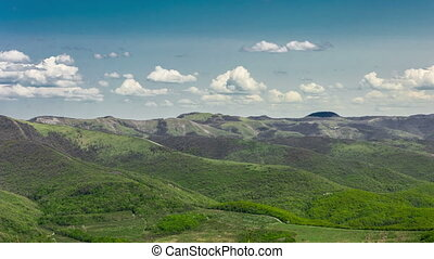 Summer mountains hills green grass and blue sky moving over landscape background. 4K time lapse