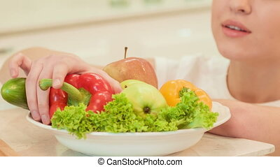 Young woman checking vegetables Organic food - They are so...