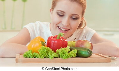 young woman looking with appetite on vegetables - I want to...