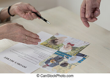 Betrayed woman - Close-up of betrayed older woman signing...