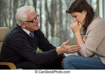 Psychotherapist comfort his client - Elderly psychotherapist...