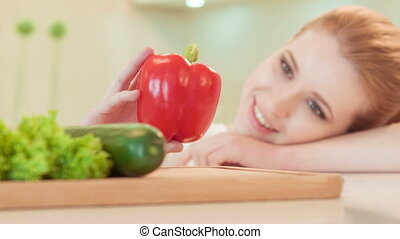 young woman playing with paprika - Nice-looking food...