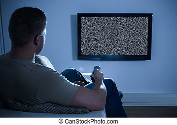 Man Watching Soccer Game On Television At Home - Man Sitting...