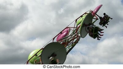 Spinning wheel at amusement park - Close up of spinning...
