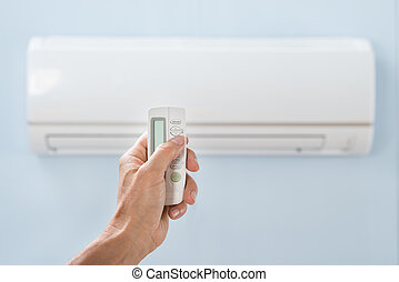 Person Hand Holding Air Conditioner Remote - Close-up Of...