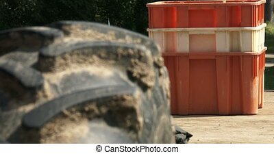 Close up of tractors tyre with crates behind ready for...