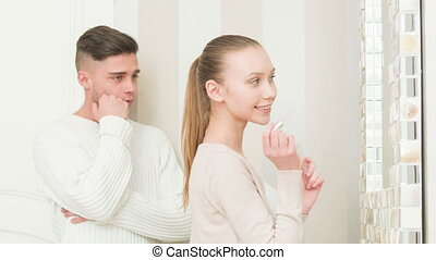 young couple preparing for party