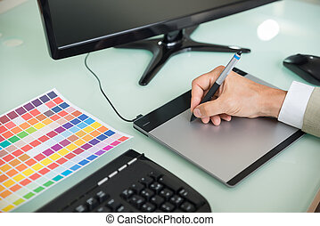 Businessman Using Graphic Tablet
