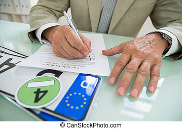 Businessman Filling Car Sale Contract - Close-up Of A...