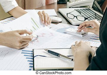 business discussion - two women discussing business plan