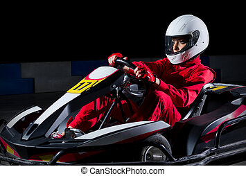 Young girl karting racer isolated