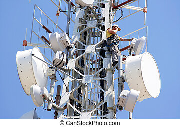 telecoms - Engineer on phone on top of telecom pylon