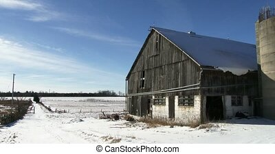 Old barn in organic farm in winter in Canada