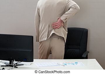 Businessman Suffering From Backache