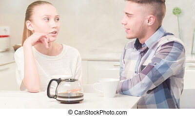 Young couple drinking tea - Do you want some tea. Happy...