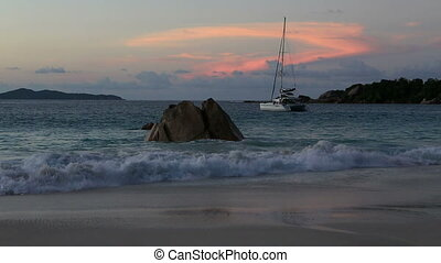 Big waves at sunset on the beach of Anse Lazio.