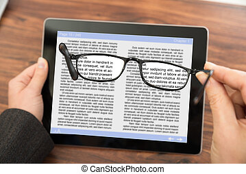 Person Reading E-book With Spectacles - Close-up Of Person...
