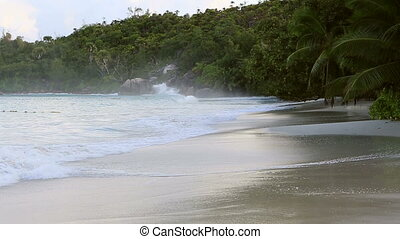 Waves at sunrise on the beach Anse Lazio.