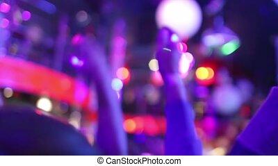 People hands up in the night club