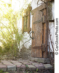 Wooden door of an old house - Threshold of the house with an...