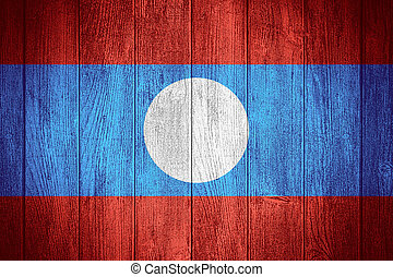 Laos flag or Lao banner on wooden boards background