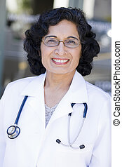 Indian Doctor - Portrait of a Mature Indian Female Doctor...